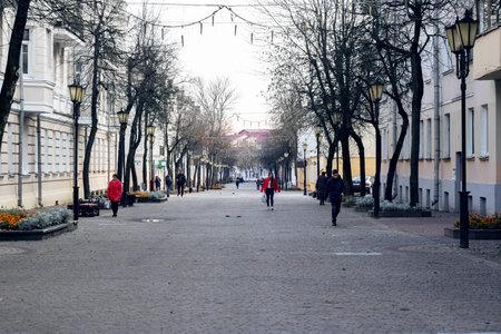 BELARUS, VITEBSK - OCTOBER 21, 2019: Pedestrian street in autumn at sunset 에디토리얼