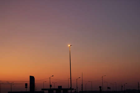 Lantern on a background of orange sunset sky 스톡 콘텐츠