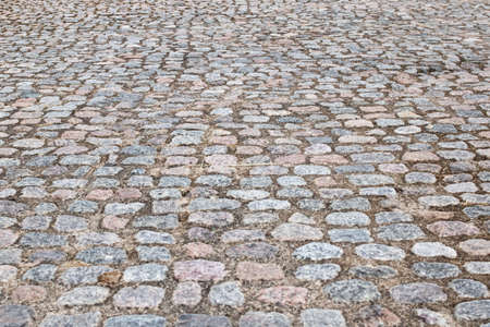 Wide pavement made of stone closeup, background or texture