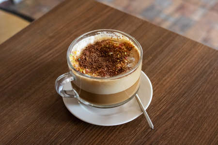 Large glass mug with coffee with milk 스톡 콘텐츠