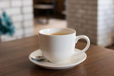 Large white mug with coffee close up