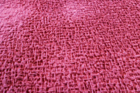 Texture of red velor fabric close up, background