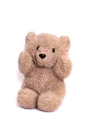 Gray toy teddy bear isolated on a white background