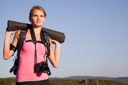 Young woman tourist in a hike on a weekend Stock Photo
