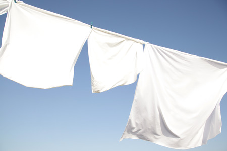 bedsheets: linens  dries in the sunlight on wind Stock Photo