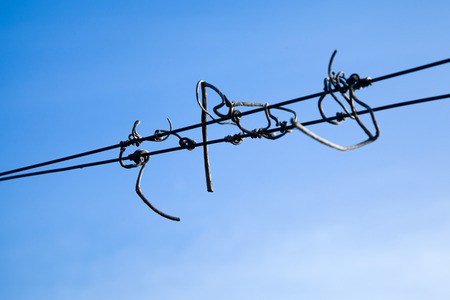 Wire against a blue sky in sunlight