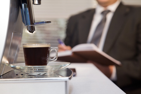 Businessman decided to use coffee without leaving the office Stock Photo