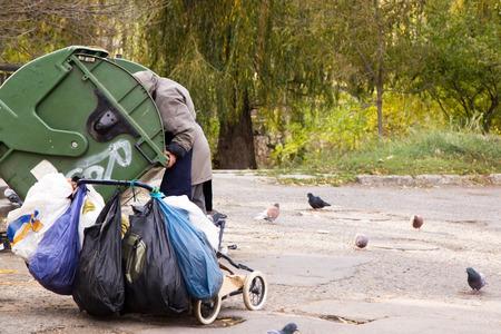 climbed: Hungry homeless climbed into trash can