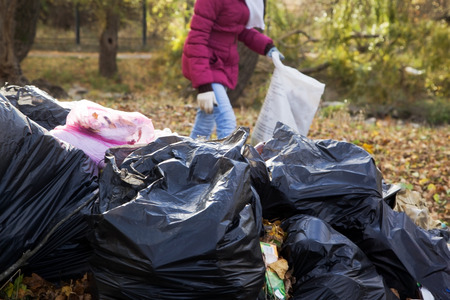 Girl activist raises trash in park cares about the environment