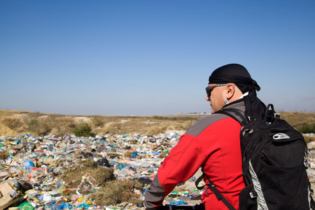 Landfill household waste on a background of blue sky Stock Photo