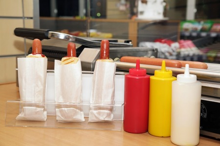 Plastic bottles with tasty sauces for of hot  hot dogs