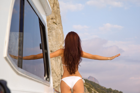 Girl enjoy the scenery on a yacht cruise with comfort