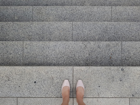 A bussiness woman on the stairs
