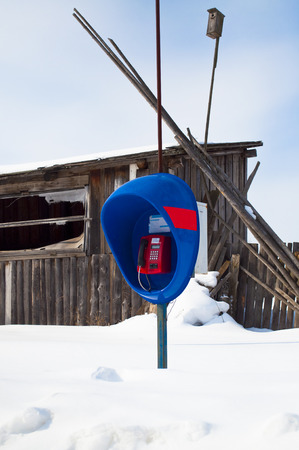barns winter: Street telephone in the village in the winter Stock Photo