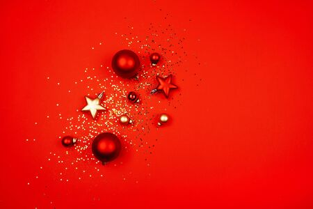 Five red christmas decoration ball on a red background with space for text Sequins, snowflakes, New Year concept.