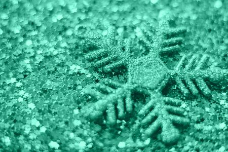 Green Christmas background from sparkles. Blurred abstract textures.