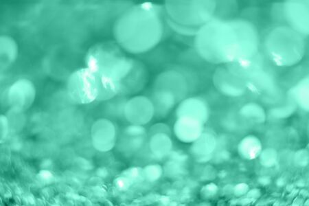Mint Christmas background from sparkles. Blurred abstract textures.