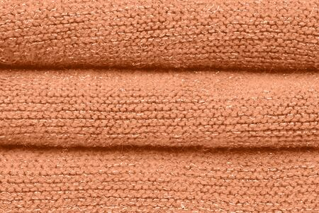 Fashion color autumn-winter 2019-2020 knitted sweater. Warm cozy home and fashion colors concept. Peach Pink. Warm and flattering. Healthy glow.