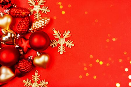 Beautiful christmas golden deco baubles on red background. Flat lay design. Copy Space. Horizontal. Stock Photo