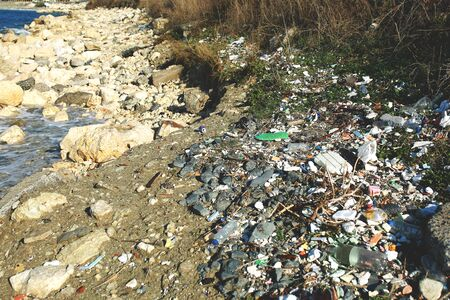 Beach pollution near see Lot of rubbish, waste, rubber tyre and single-use plastic. Reklamní fotografie