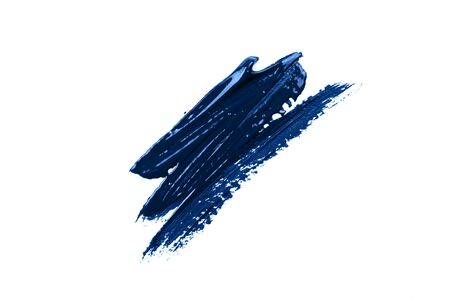 Blue stroke of the paint brush isolated on white. Classic blue color of year 2020
