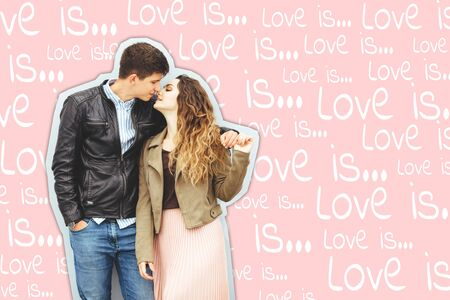 Happy loving couple isolated on gray background. stylish image, good mood, kiss in love. Beautiful elegant couple is kissing. Concept of Valentines Day. lOVE IS