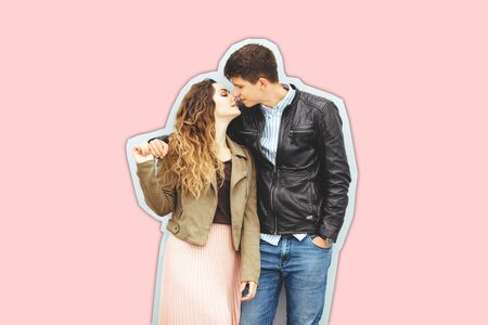 Happy loving couple isolated on pink background. stylish image, good mood, kiss in love.