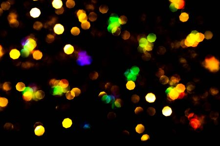 Bokeh lights on black . Beautiful Christmas background , New Year concept