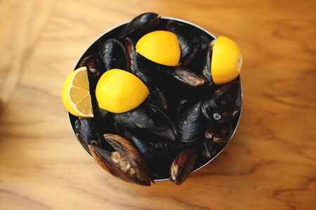 A display of fresh mussels for sale at a fish market