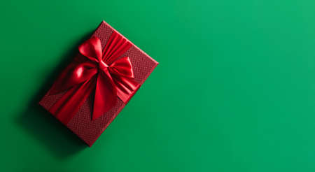 Banner of Red gift boxes on green background. Christmas card. Flat lay. Top view with space for text