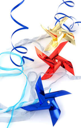 Pinwheel  gold, red and blue on white background Stock Photo