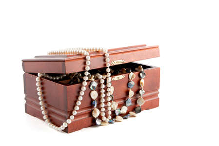 Treasure chest with jewellery,  chains and pearls  on white background