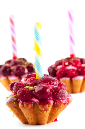 Tree cakes with raspberries and cherries Stock Photo