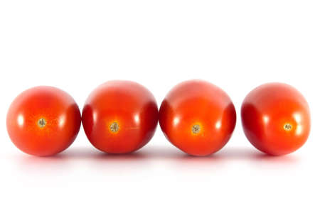 Four tomatoes on a white background