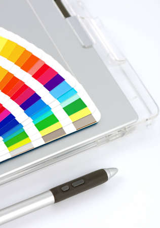 Colour Chart, Graphics Tablet And Pen, close-up view on white with feint shadow.