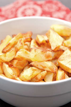 Close-up of a bowl of crisp golden potato pieces ready to be served. Stock Photo - 11982963