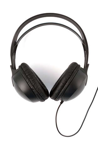 Modern Headphones Over White. A set of modern black headphones over white.