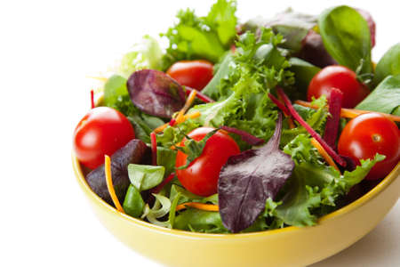Bowl of fresh crisp green salad with tomatoes and carrots for healthy eating and low calorie dieting