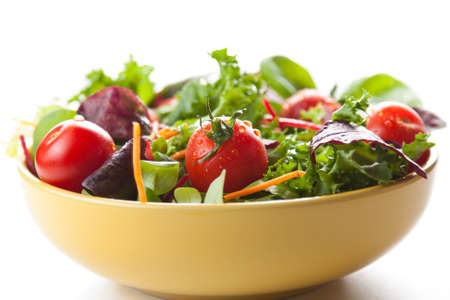 Bowl of fresh crisp green salad with tomatoes and carrots for healthy eating and low calorie dieting photo