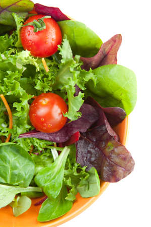 Overhead view of a serving of fresh tossed green salad in a dish accompanied by slices of freshly baked bread Stock Photo - 13646249