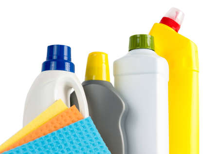 Group of blank plastic bottles used for cleaning supplies and two colourful washing cloths on white photo