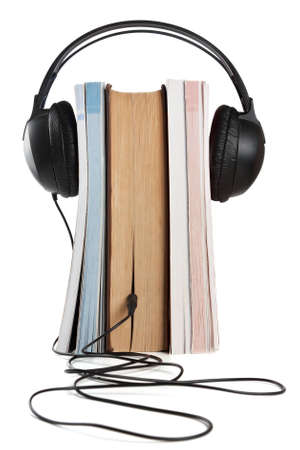 HI-Fi headphones on stack of the books on white background Stock Photo