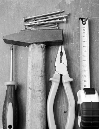 Black and white image of DIY tools and hardware used for home maintenance and repair