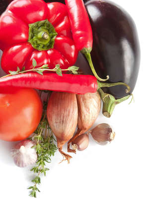 Fresh whole onion, bellpepper and brinjal waiting to be used as ingredients in vegetarian cooking