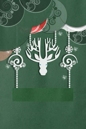 seasonal greeting: Greeting card on green with a beautiful white applique deer with large antlers amongst delicate swirled decorations and balls with copyspace for your Christmas or seasonal greeting