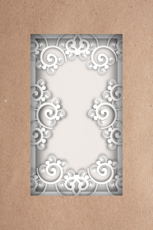 curlicue: Natural textured rectangular brown paper frame with delicate white curlicue applique decoration surrounding central copyspace
