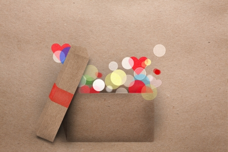 Open cardboard box with colorful lights getting out