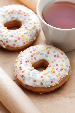 Doughnuts, sprinkled with colorful sugar and cup of tea