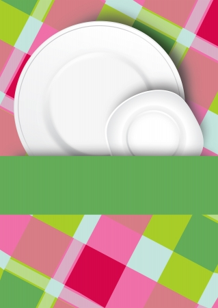 Two fresh clean white dinner plates arranged with a blank green ribbon or banner for your text over a fresh checkered country tablecloth Stock Photo