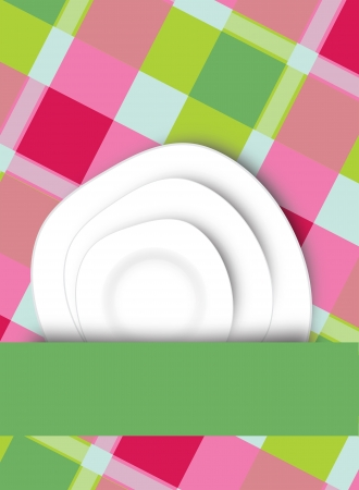 Two fresh clean white dinner plates arranged with a blank green ribbon or banner for your text over a fresh checkered country tablecloth Stock Photo - 18146510